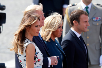 US President Donald Trump, First Lady Melania Trump, French President Emmanuel Macron and his wife Brigitte Macron leave after attending the traditional Bastille Day military parade on the Champs-Elysees avenue in Paris