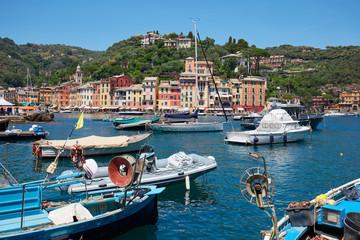 Photo sur Aluminium Bleu jean Portofino typical beautiful village with colorful houses and fishing boats in Italy, Liguria sea coast