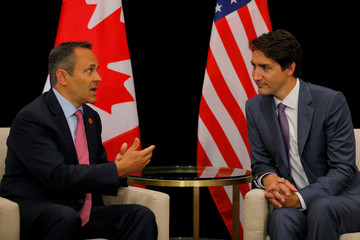 Canadian Prime Minister Justin Trudeau and Kentucky Governor Matt Bevin talk at a meeting during the National Governors Association summer meeting in Providence