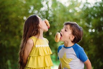 kids eating donuts on a string