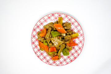 wok fried chicken stir fry with sweet peppers and chinese vegetables