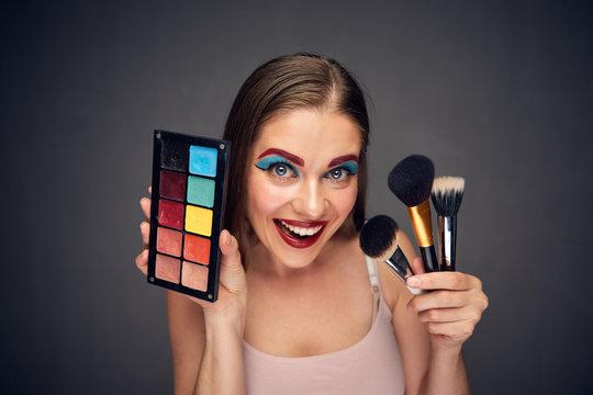 Crazy make up artist with clown worst make up.