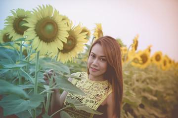Asian girl in the sunflower field