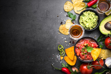Latinamerican food party sauce guacamole, salsa, chips and tequi