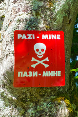 Mine or landmine symbol, warning sign