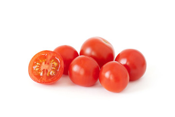 Some fresh cherry tomatoes isolated on white background