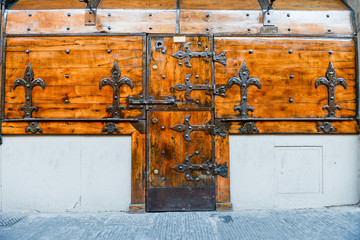 Antique closed door and windows of a shop at Firenze