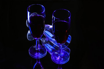 Three glasses of wine on a black background