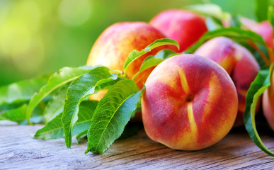 Close-Up Of Ripe Peaches On Table