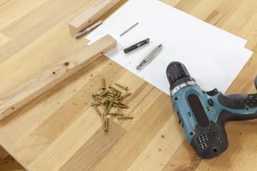 screws and an electric screwdriver