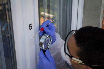 Forensic expert takes a sample of the DNA analysis