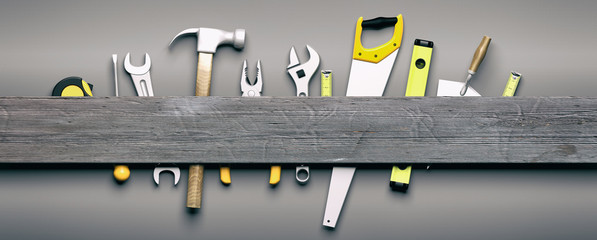 Hand tools on grey wooden background. 3d illustration Wall mural