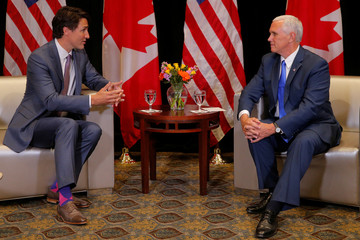 Canadian Prime Minister Trudeau and United States Vice President Pence meet at the National Governors Association summer meeting in Providence