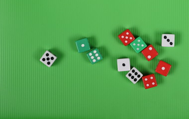 Gambling dice on green background and texture