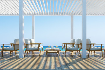 Cafe on a seaside, white armchairs