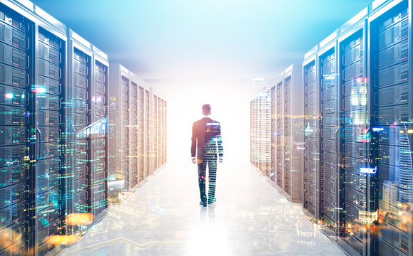 Rear view of man in a server room, city