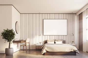 Beige bedroom with a large poster