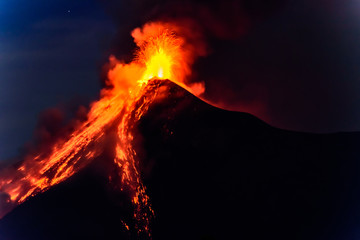 Lava spurts from erupting Fuego volcano in Guatemala