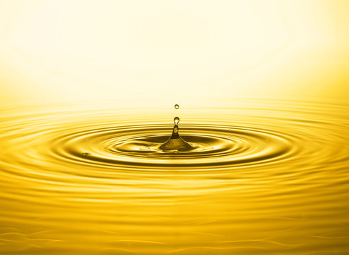 Close up of golden water drop