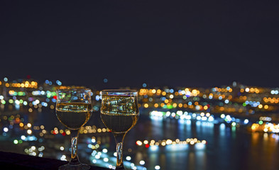 view the city at night, the bridge across the Bay at night, glasses through whic