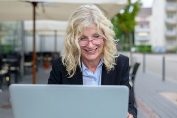 Middle-aged businesswoman working on her laptop