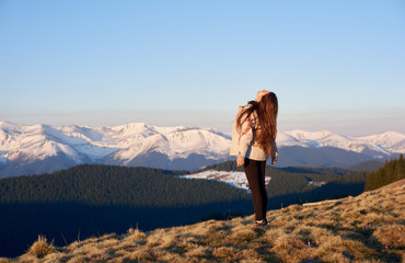 Rearview shot of a woman hiking in the mountains looking in the sky copyspace nature beautiful landscape hiker sportive human lifestyle active concept