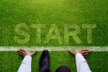Start background, Top view of Businessman on Start line in soccer grass field, Business Challenge or do something new