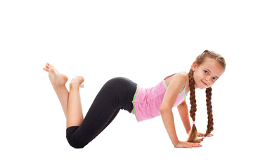 Young girl doing gymnastic exercises - isolated