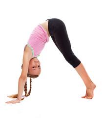 Young girl doing gymnastic floor exercises