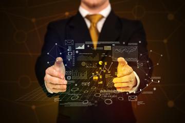 Businessman holding business plan graphics