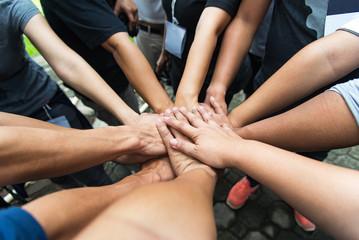 Group of people United Hands to built teamwork together with Spirit - teamwork concepts,teamwork