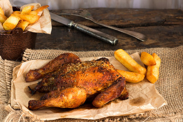Roasted spatchcock poussin with potato chips