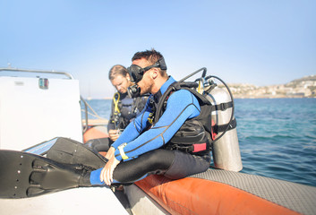 Recess Fitting Water Motor sports Scuba diver on a boat, ready to jump in the water
