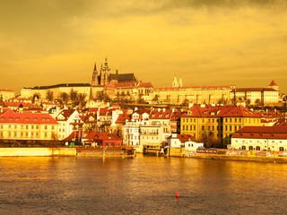 Prague Castle and Vltava River illuminated by golden sunrise, Prague, Czech Republic.
