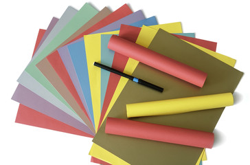 Sheets of colored paper on a white background.