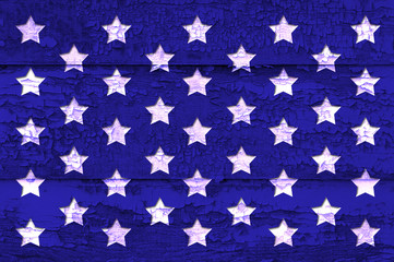 Old weathered wood board with cracked paint, dark blue with white stars, Labor Day, Independence Day, copy space, background.