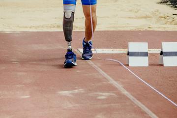 leg athlete paralympic handicap long jump track stadium