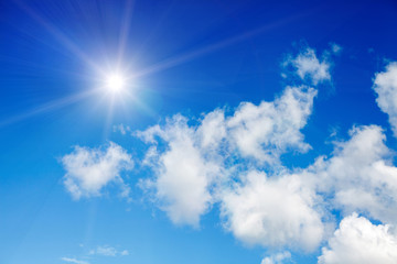 Sun with clouds on a blue background