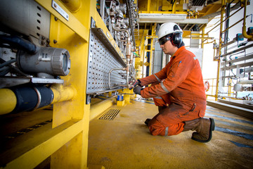 Technician,Instrument technician on the job recoad morning data or function check pressure transmitters in process oil and gas platform offshore,technician