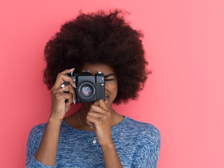 young black girl taking photo on a retro camera