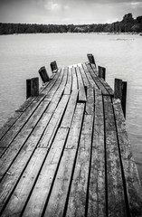 Old wooden foot bridge in sea