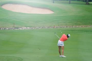 Woman golf is a sport requiring heat tolerance.