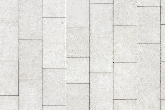 Floor of white stone slabs