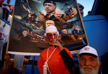 A man poses with an effigy of U.S.-based Turkish cleric Fethullah Gulen during a ceremony marking the first anniversary of the attempted coup at the Bosphorus Bridge in Istanbul