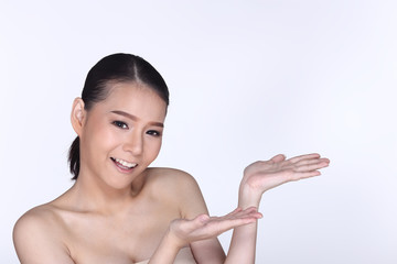 Young White Asian woman fahion make up showing empty copy space on the hand palm
