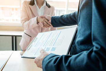 of successful business team shaking hands with each other in the office, job interview concept