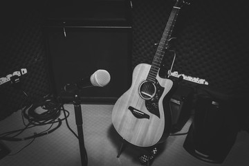 Black and White photo concept.the music band in the studio recording with Instrument is microphone classic guitar and speaker for live concert background.