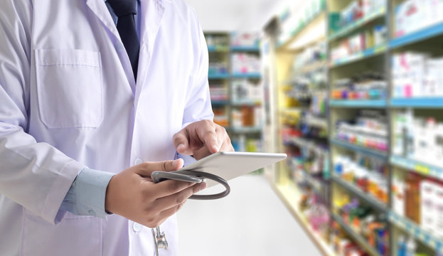 The pharmacist working pharmacy technician  drugstore healthcare concept Empty copy space for content