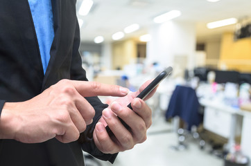 Businessman using phone in the work office.