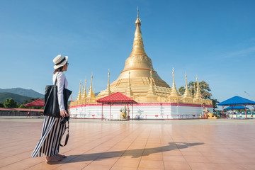 Asian girl travel and see the mockup Shwedagon pagoda in Tachileik border town in Shan State of Myanmar.